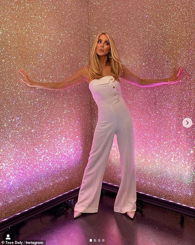 'It's that time again!': Presenter poses in front of a stunning pink wall ahead of launch show, revealing this year's dancer duo