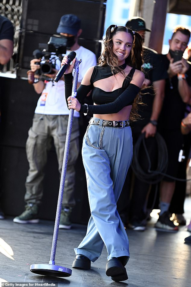 Stardom: Olivia Rodrigo, 18, also performed at the event wearing a black cutout cropped top that exposed her tiny waist and showed off her cleavage paired with tailored blue pants