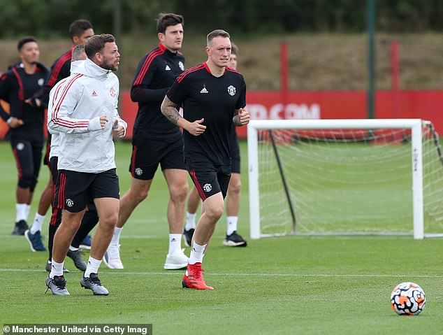 Jones (right) is now back training with Man United and has played for the club's reserve team