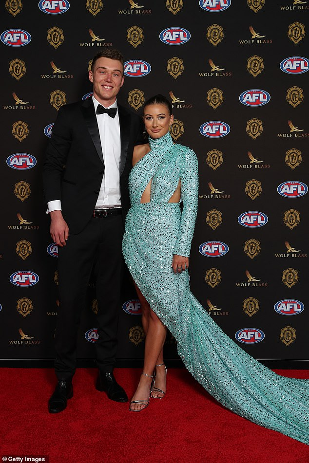 All That Glitters: Carlton player Patrick Cripps, 26, joined Monique Fontana on the red carpet, the brunette beauty opting for a glitzy teal dress with a dramatic train and racy cutouts at the waist