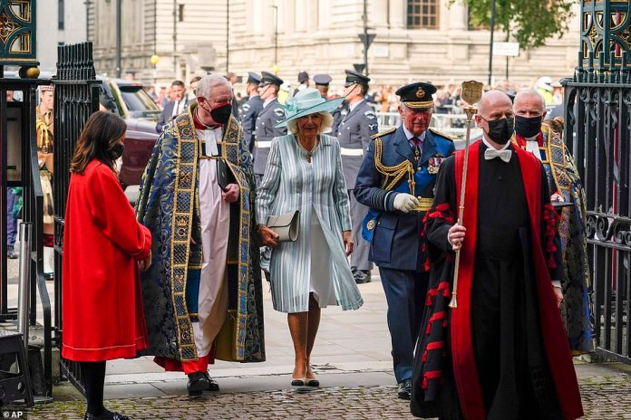 Caution: The royal family opted not to go out into the fresh air when the clergy wore face masks as they escorted Charles and Camilla through the abbey's entrance.
