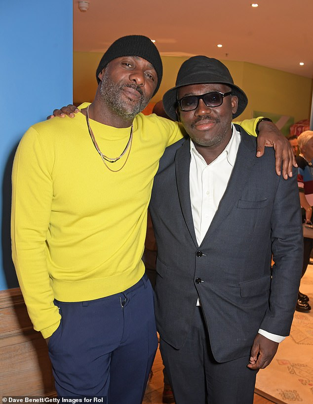 Accessories: He accessorised with a series of chains around his neck, while he opted to wear a trendy black beanie. Pictured withEdward Enninful