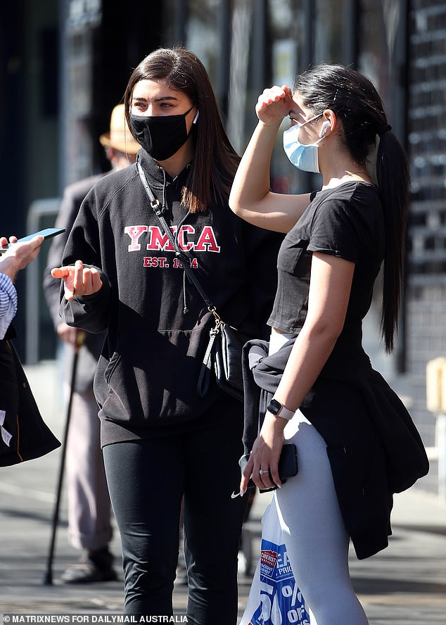 Recreation rules in Sydney's locked-down west (sisters in Bankstown, above) and south-west will relax from today as vaccination rates continue to climb
