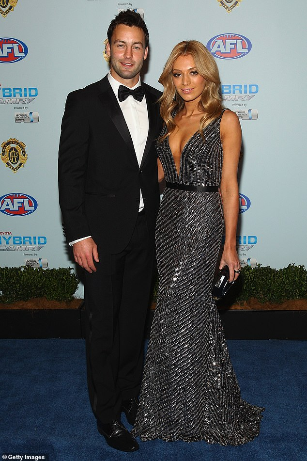 Ouch: As he fired off a slew of tweets mocking the AFL's night of nights, the Collingwood great told fans 'a lot' of jokes about Nadia had been rejected by Sportsbet's social media team. Nadia is pictured with ex-husbandJimmy Bartelof the Geelong Cats at the2010 BrownlowMedal