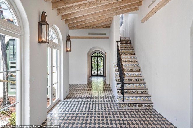 The staircase is decorated with imported tiles, adding to the Mediterranean aesthetic