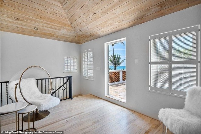 A patio extends off of the large, primary bedroom