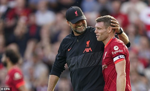 Jurgen Klopp (left) cheekily suggested that James Milner (right) 'loved' playing as a right-back