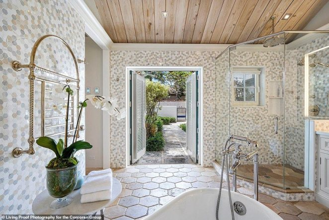 The house also has 10 full bathrooms and four half baths, with limestone details