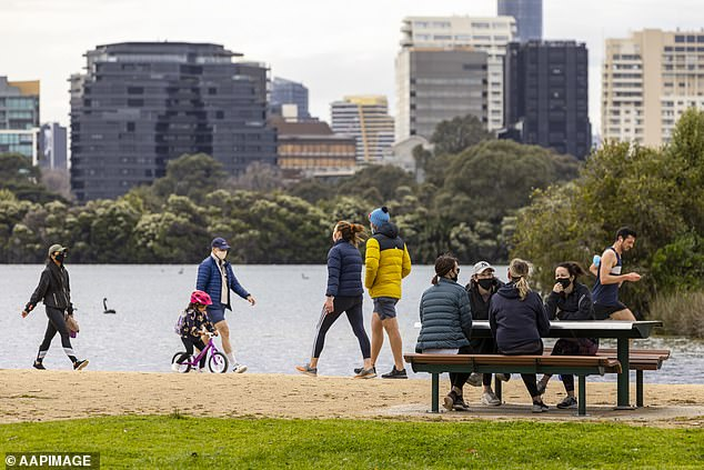 'We need to look at outdoors as the main place where we can lift as many restrictions as safely as possible,' Dr Coatsworth said. Pictured are Melburnians enjoying the outdoors