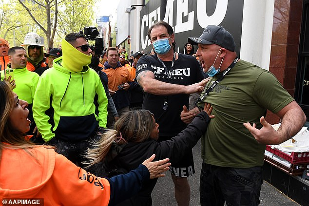 Construction workers clashed with union officials in ugly scenes earlier on Monday
