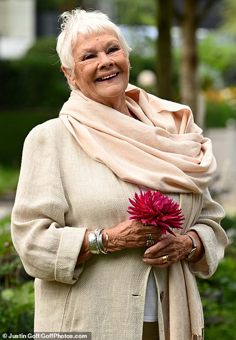 Dame Judi Dench, 86, seemed delighted to be attending this year's event today