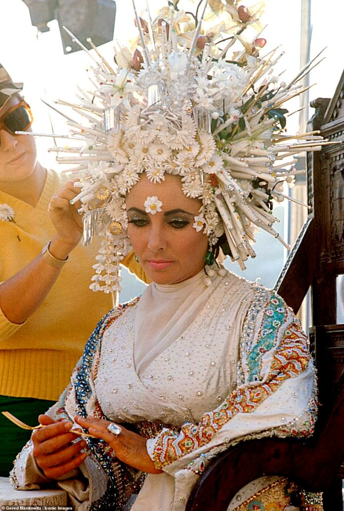 Another Sardinian snap of Mankowitz on the set of Joseph Losi's romantic drama, Boom!  This time Taylor is seen wearing a wide head dress