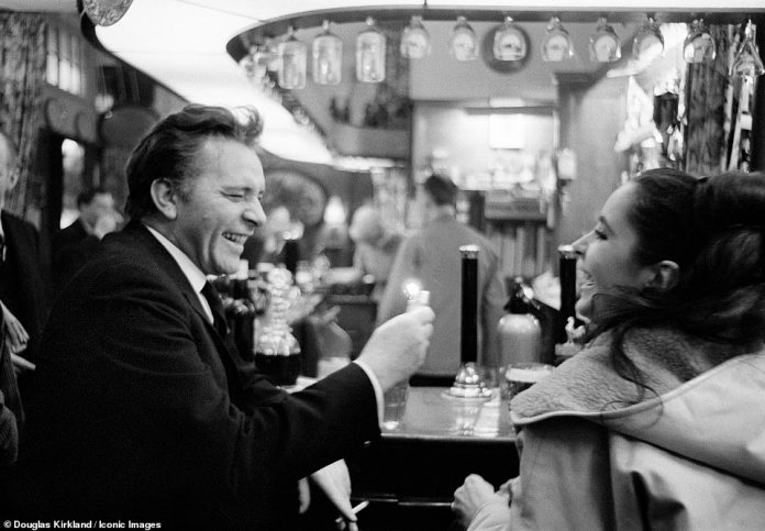 A different side: The couple's famously intense relationship was also captured in these photos at the bar at the George V Hotel in Paris in 1965.
