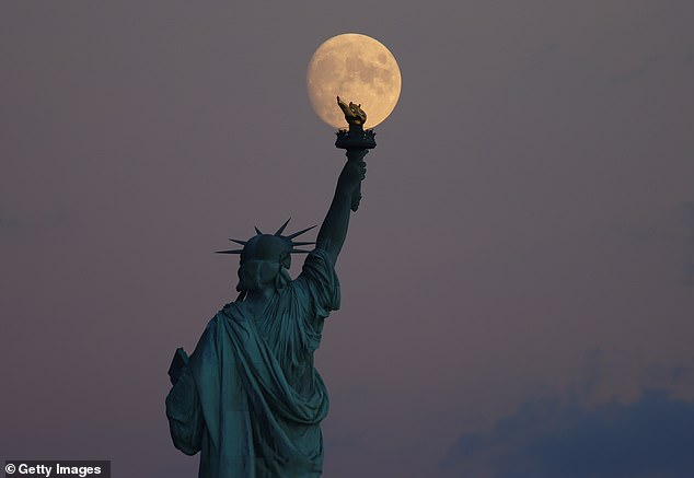 It is the closest full moon to the autumnal equinox, which falls on September 22, the moment the Sun appears to cross the celestial equator.  Here the 95% full waxing crescent moon can be seen rising behind Lady Liberty