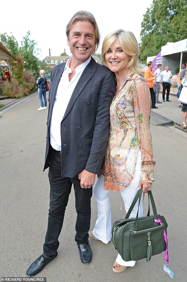 Say Cheese: TV presenter Anthea Turner looked radiant on Monday while attending the annual Chelsea Flower Show with fiancé Mark Armstrong
