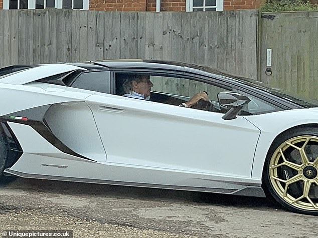 Back Behind the Wheel: Rod Stewart, 76, was seen driving again for the first time in his white Lamborghini, as he strolled past a local Essex cafe for breakfast.