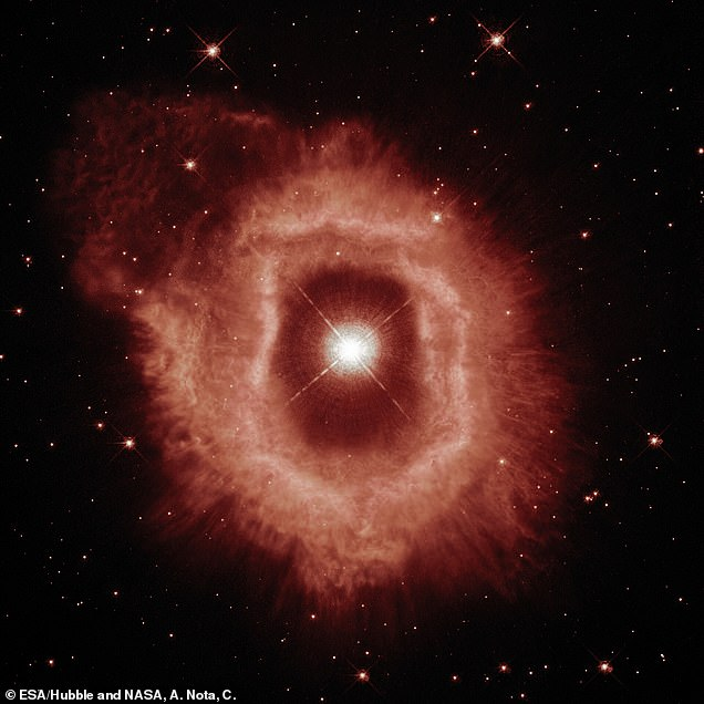 The center was cleared by dust and gas, which likely collided with the dust, leaving the thick bright red ring that appears in the first image