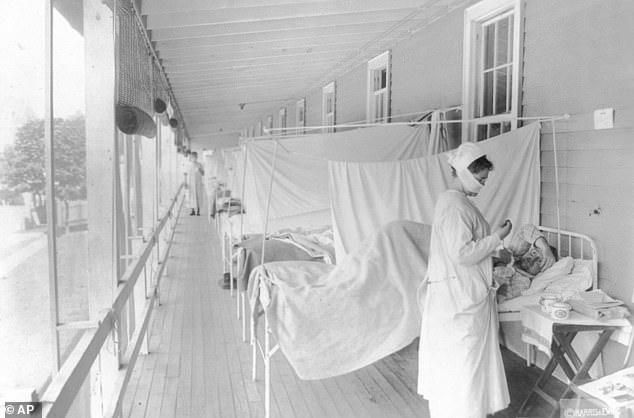 However, the death rate in 1918 was much higher because the overall US population was small, with 204 Covid deaths per 100,000 Americans compared to 642 Spanish flu deaths per 100,000 people.  Pictured: A nurse takes the pulse of a patient in the influenza ward of Walter Reed Hospital in Washington, DC, November 1918