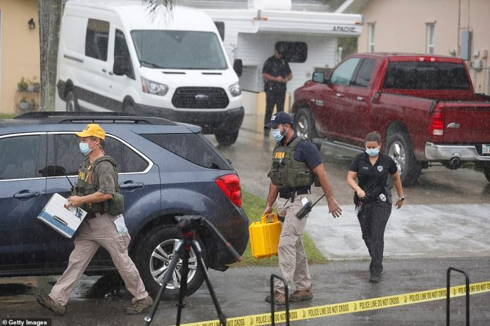 FBI agents are seen searching the family home of Brian Laundrie on September 20