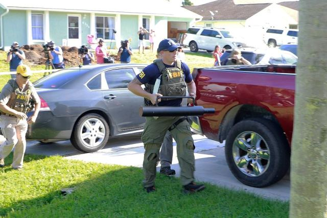 An FBI agent is pictured at the North Port home of Laundrie's parents on September 20