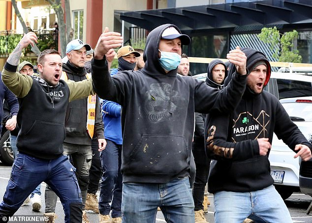 On Monday night, the Victorian government shut down the construction industry for two weeks in metropolitan Melbourne, Ballarat, Greater Geelong, Surf Coast Shire and Mitchell Shire. Protesters are pictured at CFMEU headquarters in Melbourne