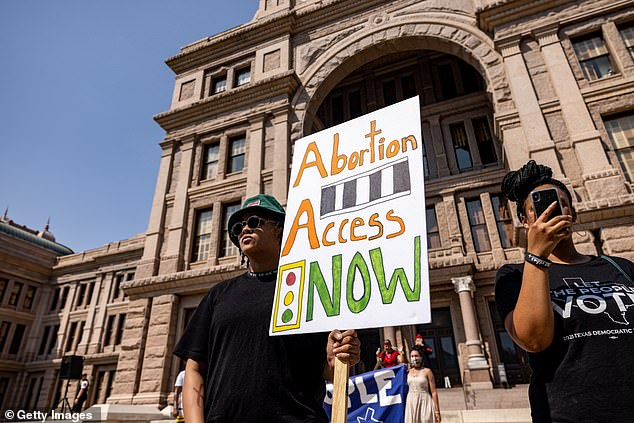 A woman calls for access to abortion (pictured) at a rally at the Texas State Capitol on September 11, 2021 in Austin, Texas.  Texas lawmakers recently passed legislation, including SB8, which prohibits abortion in Texas after a fetal heartbeat is detected on ultrasound, usually between the fifth and sixth weeks of pregnancy.
