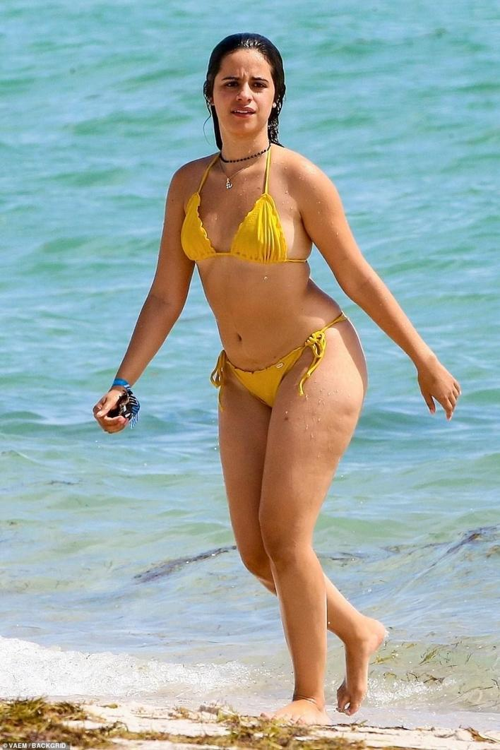 Beach babe!Camila Cabello sent temperatures soaring in a thong bikini as she hit the beaches of Miami on Monday