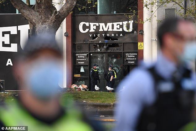 Hundreds of workers in hi-vis vests gathered outside the CFMEU's Elizabeth Street head office on Monday, hurling abuse and projectiles and smashing windows. Victorian Premier Dan Andrews has since shut down the construction industry for at least a fortnight.