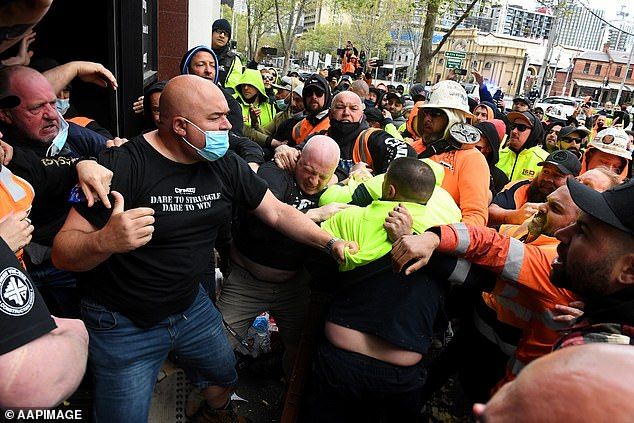 CFMEU boss John Setka has distanced the union from protesters objecting to mandatory Covid-19 vaccine requirements, which come into effect for the construction industry later this week. Construction workers are pictured clashing with union officials on Monday