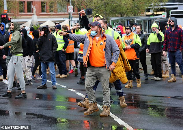 Protesters clashed with police on Monday in Melbourne to demonstrate against mandatory vaccination
