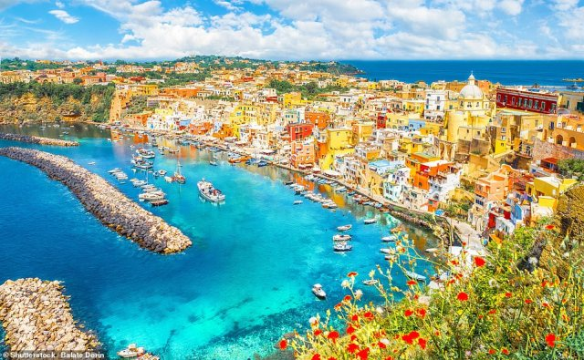 Refreshing: The harbour at Procida, which is an island famed for fragrant lemons that 'grow as big as fists on trees between buildings dripping with bougainvillea'