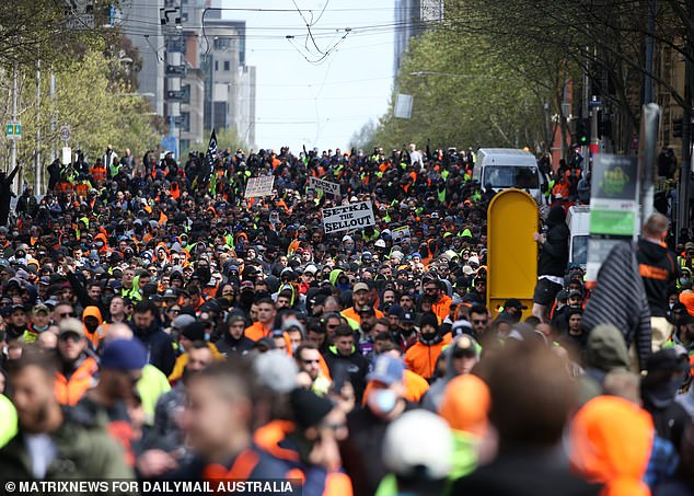 Thousands of angry tradies gathered in Melbourne to protest mandatory Covid jabs for a second day on Tuesday