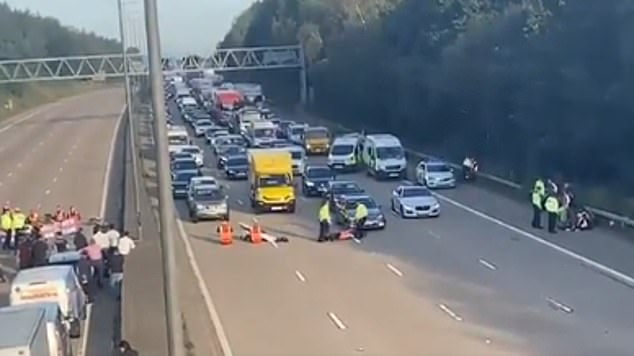 More than 30 protesters have been seen running into flowing traffic near Woking today. There are groups on both sides of the eight lane motorway
