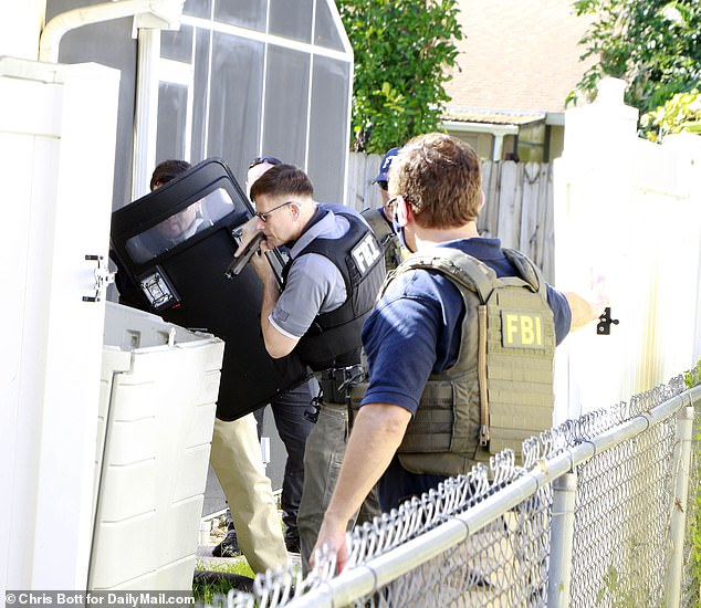 It appeared at one point that FBI officers were looking for Brian Laundrie at the house. Five FBI agents at the side of the property searched a plastic garden lidded container