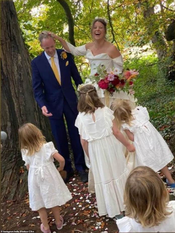 The bride (pictured with her flower girls) looked stunning in an off-the-shoulder princess gown, which featured a ruffled skirt and a ruffled bodice