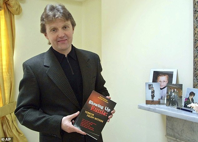 Litvinenko, 43, (pictured in 2002 with his book in which he accused the Russia state of terror acts to bring Putin to power) died weeks after drinking green tea laced with polonium-210