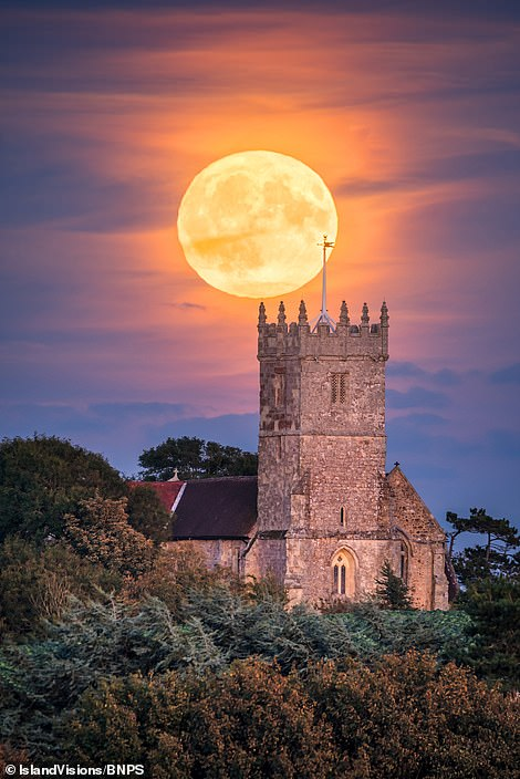 Landscape photographer Jamie Russell captures the Harvest Moon rising above All Saints Church in the parish of Godshill on the Isle of Wight