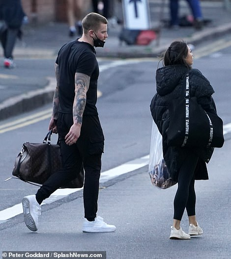 Back it up: He stowed his stuff in a trendy Louis Vuitton holdall