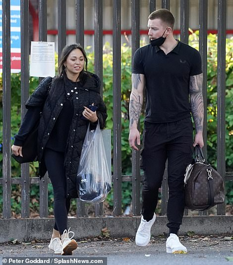 Stylish: They were engrossed in chatting and sporting matching black looks