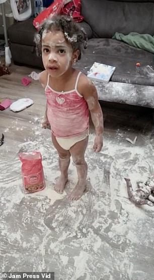 A father-of-three who had turned his back for just a few minutes was left shocked when his daughters managed to get into a bag of flour, leaving themselves (pictured) and the living room coated in it