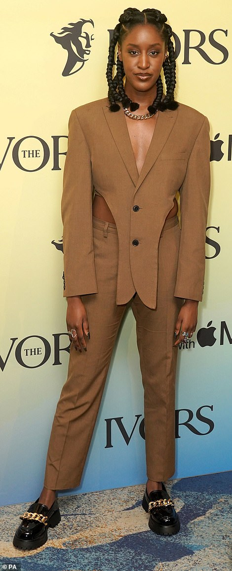 A vision:Seven Nights singer Mysie, suited up in a chic tan number with cut-out hips and chunky loafers