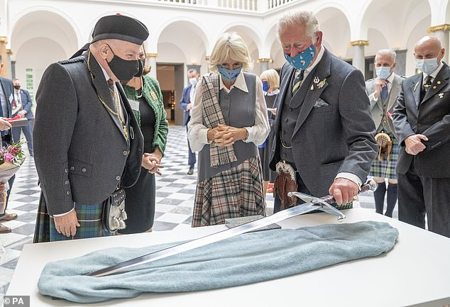 The Prince of Wales and the Duchess of Cornwall were presented with a replica of the sword of Robert the Bruce during a visit to the redeveloped Aberdeen Art Gallery