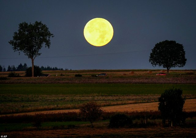 The full moon sets behind the hills of the Taunus region near Wehrheim, Germany.According to NASA used the light of the full moon closest to the equinox to extend their workday beyond sunset before electric light was invented