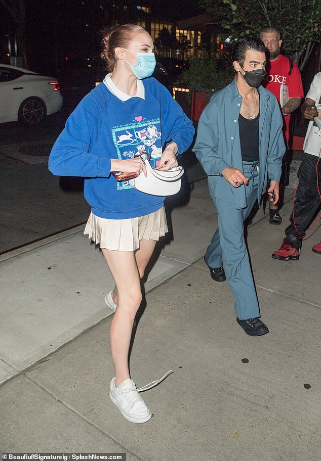 Date night: The actress looked cosy in a vintage looking blue sweatshirt while the singer donned an oversized blue workman shirt with matching baggy trousers