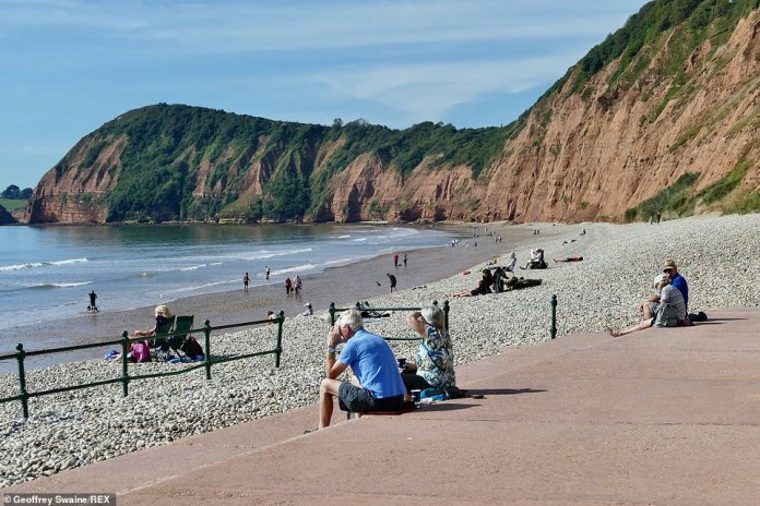 On the last day of summer, people relax on Jacobs Ladder Beach as they make the most of the unseasonably warm weather. Temperatures today are above the average expected at this time of year