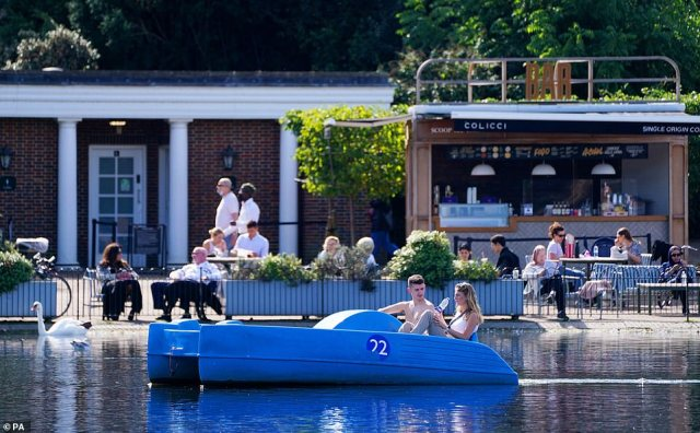 One pedalo-user ditched his t-shirt as temperatures in London's Hyde Park stayed approximately 10F higher than the average at this stage of September