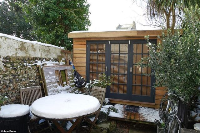 The shed covered in snow last winter after Jonathan completed it. The study built has survived the harsher weather of the cold months