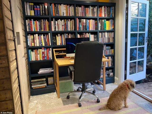 The family dog enjoying the shed. A year on from building the shed himself, Jonathan said he wouldn't go back to working from the living-room for the world