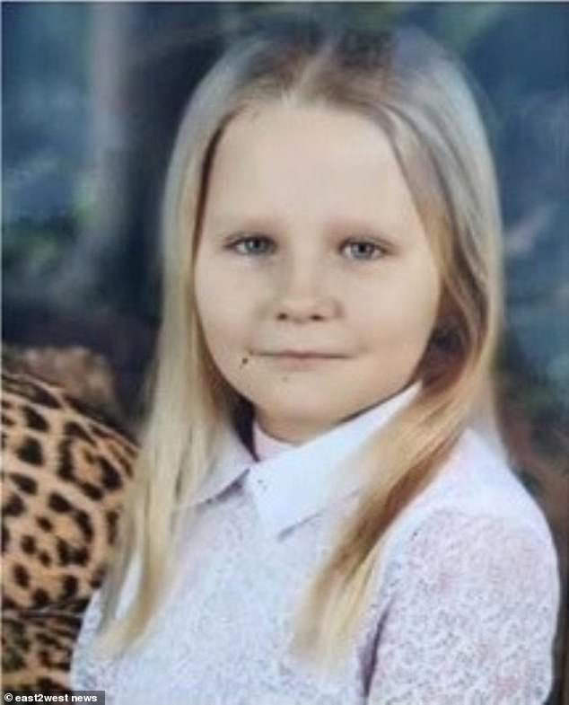 The body of nine-year-old Viktoria Gnedova (pictured) was found buried seven feet beneath a concrete slab in the cellar of her apartment block