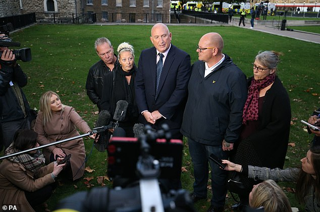 Spokesman Radd Seiger for the family of Harry Dunn, flanked by mother Charlotte Charles and father Tim Dunn